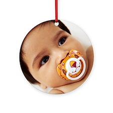 Baby boy sucking a dummy Round Ornament