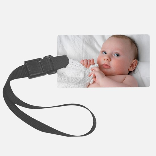 Baby lying on his back Luggage Tag