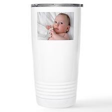 Baby lying on his back Travel Coffee Mug