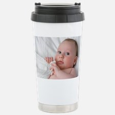 Baby lying on his back Travel Mug