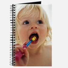 Baby girl brushing teeth Journal