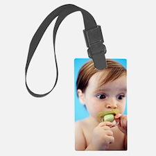 Baby girl sucking a dummy Luggage Tag