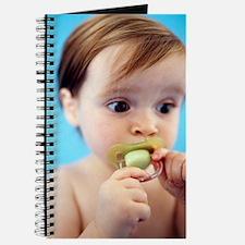 Baby girl sucking a dummy Journal