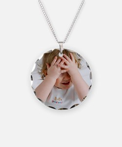 Baby boy playing Necklace