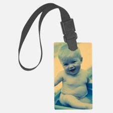 Baby boy playing Luggage Tag