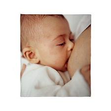 Baby girl breastfeeding Throw Blanket