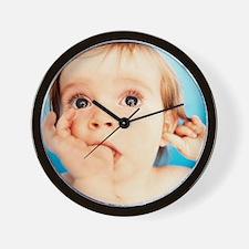 Baby girl sucking thumb Wall Clock