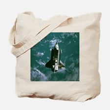 Space shuttle Challenger orbiting earth Tote Bag