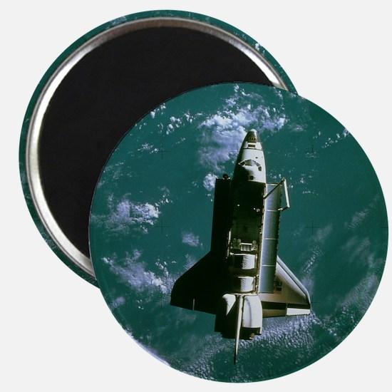 Space shuttle Challenger orbiting earth Magnet