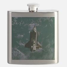 Space shuttle Challenger orbiting earth Flask