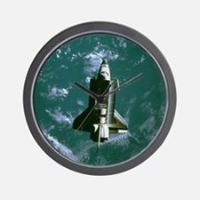 Space shuttle Challenger orbiting earth Wall Clock