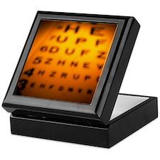 Blurred view of a Snellen eye test ch Keepsake Box
