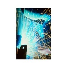 Sparks flying from an argon welde Rectangle Magnet