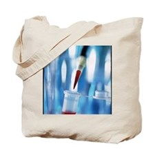Blood sample being pipetted into a microt Tote Bag
