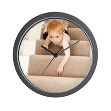 Boy climbing stairs Wall Clock