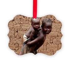 Child carrying a baby Ornament