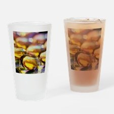 Bubble pack of cod liver oil capsul Drinking Glass
