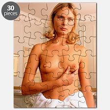 Breast self-examination: woman squeezes nip Puzzle