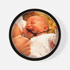 Breast-feeding: baby's crying causes mi Wall Clock