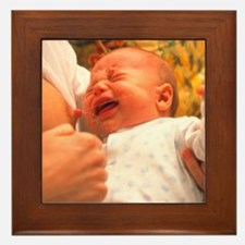 Breast-feeding: baby's crying causes m Framed Tile