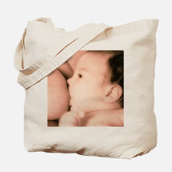 Close-up of a baby feeding at his mother' Tote Bag