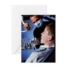 Dentist examining a boy's mouth Greeting Card