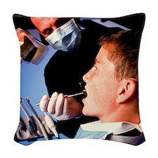 Dentist examining a boy's mout Woven Throw Pillow