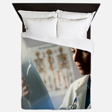 Female doctor studying an X-ray image Queen Duvet