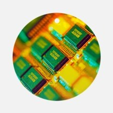 View of a circuit board from a Maci Round Ornament