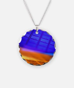 View of two silicon wafers w Necklace