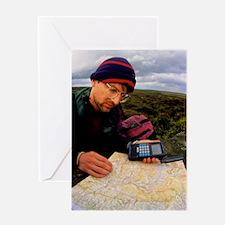 Walker using hand-held GPS receiver Greeting Card