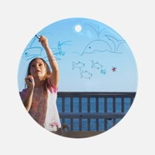 Girl drawing Round Ornament