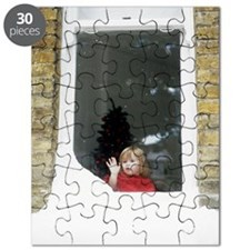 Girl staring out of snowy window Puzzle