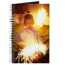 Girl holding sparkler Journal