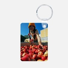 Woman collecting apples Keychains