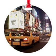 Taxis driving through times square  Ornament