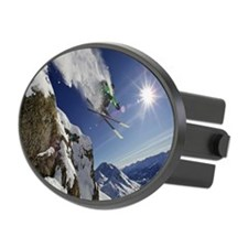 Skier in midair on snowy mountain Hitch Cover