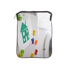 Picture of green house on fridge. iPad Sleeve