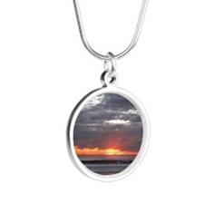 Sunset over Pacific Ocean. Silver Round Necklace