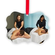 Couple receiving massages from wo Ornament
