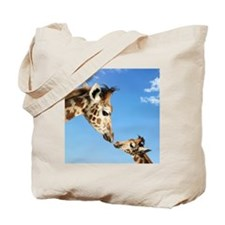 Young and Adult Giraffes Looking Face to  Tote Bag