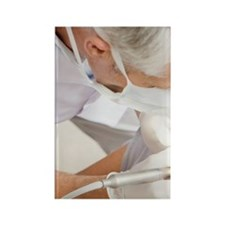 Dentist working on patients teeth Rectangle Magnet