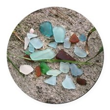 Beach glass on a rock Round Car Magnet