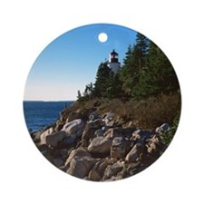 Lighthouse on shore Round Ornament