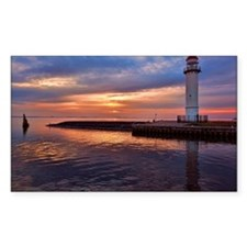 Lighthouse on jetty at sunset Decal