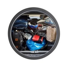 A packed trunk on a car. Wall Clock