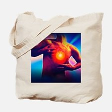 Man holds his chest due to angina or hear Tote Bag