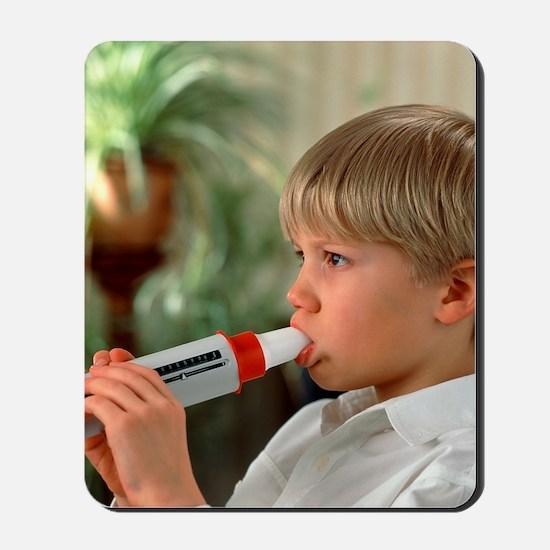 Lung function: boy breathes into peak fl Mousepad