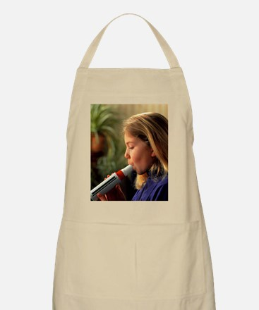 Lung function: girl breathes into peak flow  Apron