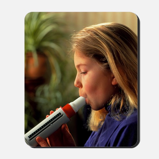 Lung function: girl breathes into peak f Mousepad